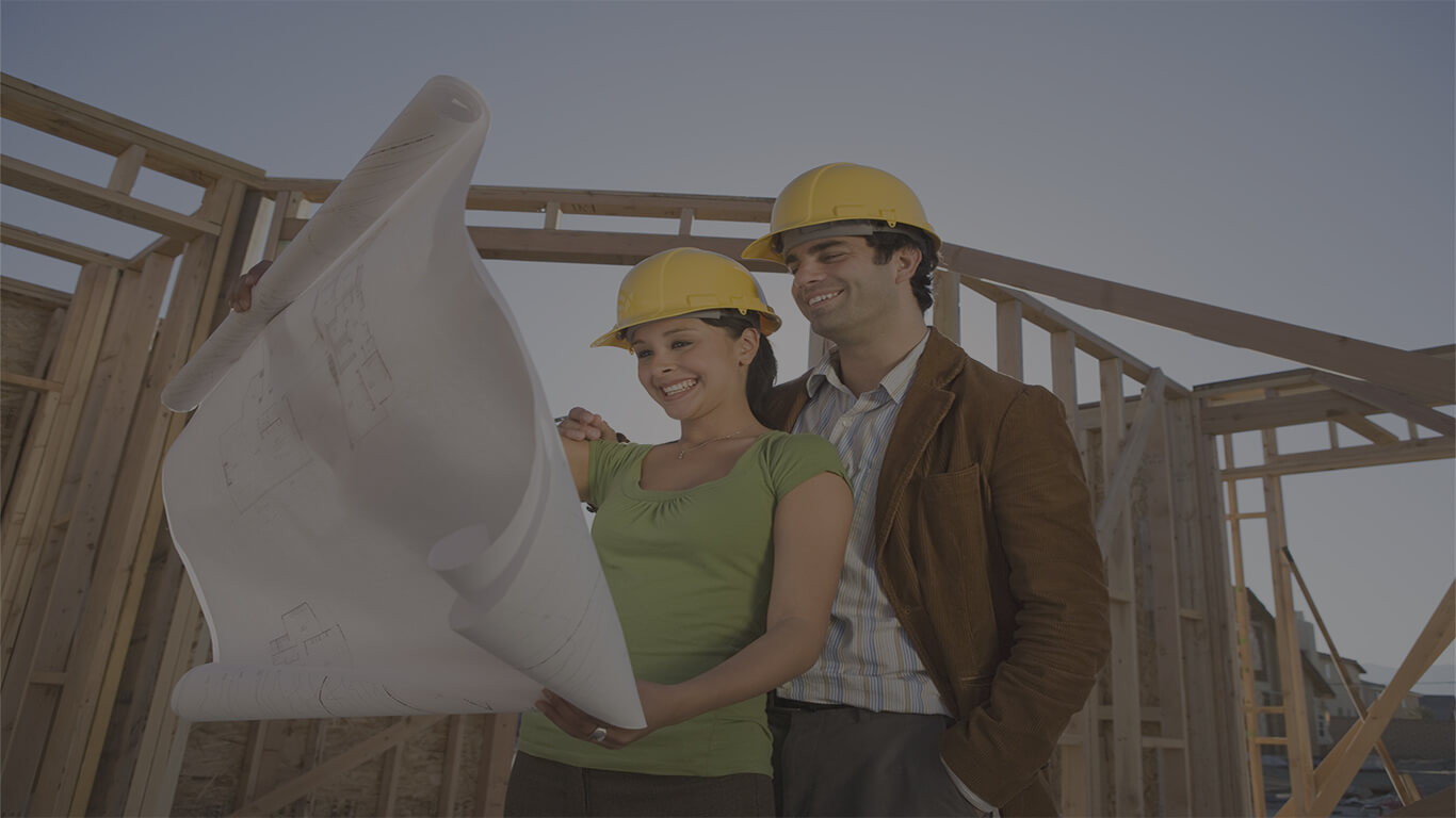couple with plans at construction site_website
